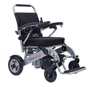 The Freedom electric wheelchair showing its compact size and folding frame